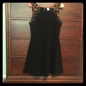 Dresses & Skirts - Black dress with leopard and leather sleeve detail